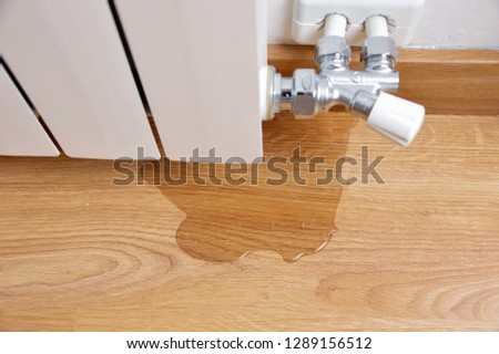 water leak through the heating radiator tube nut Royalty-Free Stock Photo #1289156512