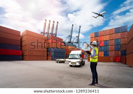 Foreman control loading Containers box to truck for Logistic Import Export Background, Business logistic concept, import and export concept #1289236411