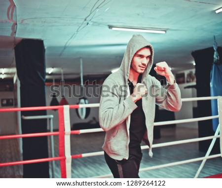 The guy in the hoodie boxing without gloves in the ring #1289264122