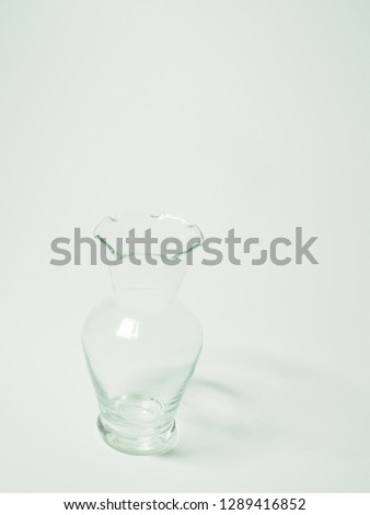 Empty glass flower vase with no flowers #1289416852