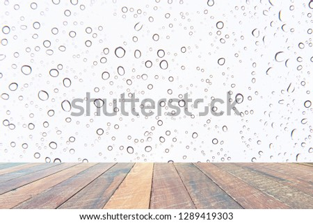Water drops , Rain droplets on white background and empty wood desk .Blank space for text and images. #1289419303