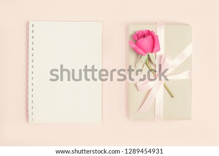 Gift box with rose on pink bacground. Vintage present. Gift box with pink ribbon and bow. Greeting card for Birthday, Womens or Mothers Day #1289454931