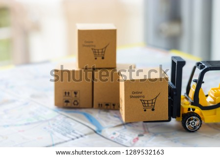 Mini forklift truck load cardboard box with text online shopping and symbols on street map. Logistics and transportation management ideas and Industry business commercial concept. #1289532163