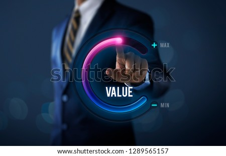 Growth value, increase value, value added or business growth concept. Businessman is pulling up circle progress bar with the word VALUE on dark tone background. #1289565157