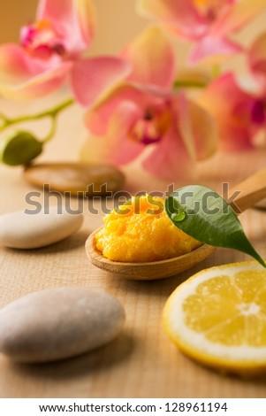 Mango body butter, spa stones and lemon. #128961194