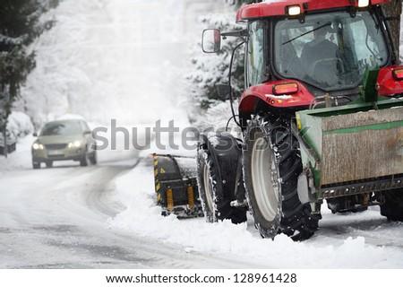 Snowplow and car #128961428