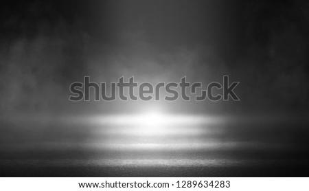 Black background of empty street, room, spotlight illuminates asphalt, smoke #1289634283