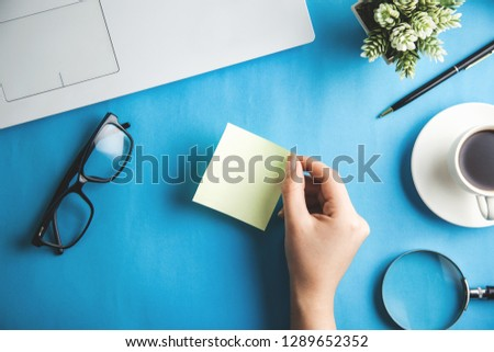 woman hand page with keyboard on office desk #1289652352