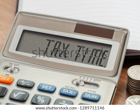 Tax Time word on calculator. Business and tax concept. Time to pay tax in year. #1289711146