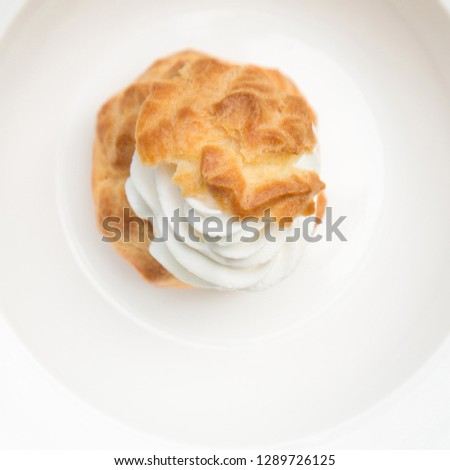 Top view of One Choux Cream in plate  #1289726125