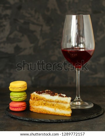 red wine, cake and macaroons, dessert (sweets). food background. top photo #1289772157