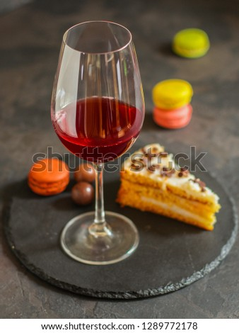 red wine, cake and macaroons, dessert (sweets). food background. top photo #1289772178