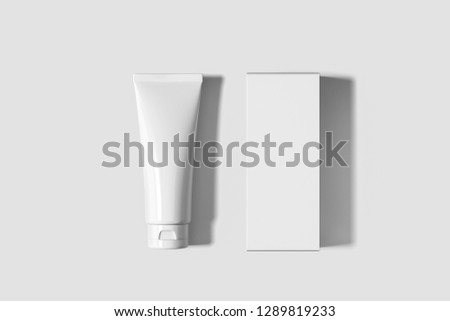 Cosmetic White Plastic Tube with cardboard box mock-up  Isolated on soft gray background. Mock Up.Сan be used for design and branding.High resolution photo. #1289819233