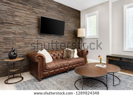 Living Room Interior and Den in Luxury Home with Rock Wall  #1289824348