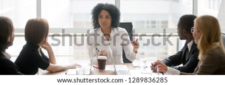 Horizontal photo people sitting at boardroom african business woman talking with staff at formal meeting briefing, diverse client partners listens boss ceo team leader banner for website header design #1289836285