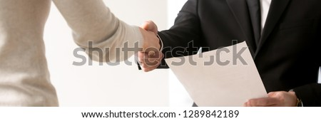 Close up hands of businesspeople greeting each other starting negotiations, hr manager handshaking with vacancy candidature, human resources concept. Horizontal photo banner for website header design