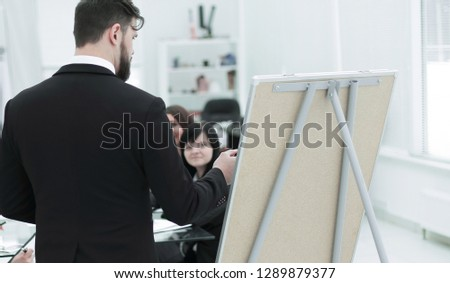 rear view. a businessman makes a presentation to employees #1289879377