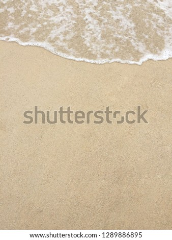 Soft wave of sea on the sandy beach. Background. Copy space. #1289886895