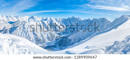 Wide panoramic view of winter landscape with snow covered Alps in Seefeld in the Austrian state of Tyrol. Winter in Austria Royalty-Free Stock Photo #1289909647