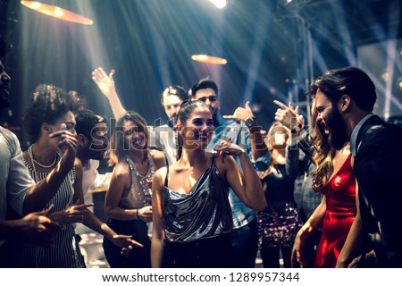 Group of people dancing in the club #1289957344