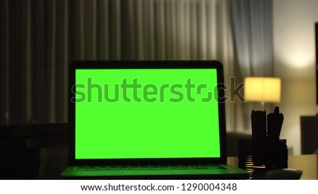 Close-up shot , Laptop with green screen indoors for replacement with blur background  #1290004348