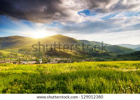 Majestic mountains landscape under morning sky with clouds. Overcast sky before storm. Carpathian, Ukraine, Europe. #129012380