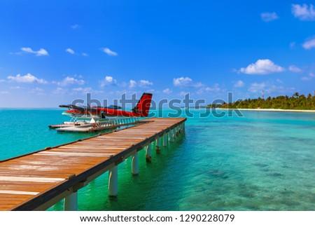 Seaplane at Maldives - nature travel background #1290228079