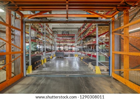 Factory warehouse steel reinforcement. High stacked shelving. Industrial distribution warehouse. #1290308011