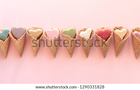 Valentine's day background. Ice cream waffle cone with ginger cookie in shape heart on pink background. Valentine day concept, design. Flat lay, top view, copy space  #1290331828