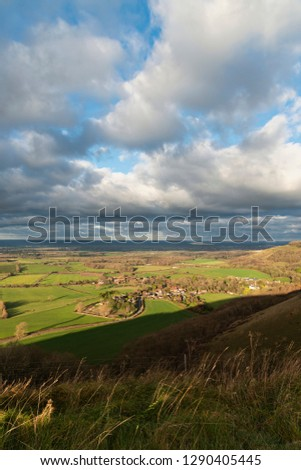 Beautiful Autumn Fall landscape of South Downs National Park in English countryside in late afternoon light on cold day #1290405445