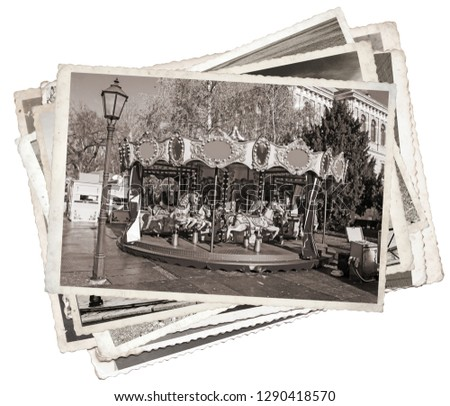 Black and white photos of Old fashioned french carousel with horses Stack