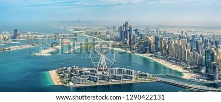 Panoramic aerial view of Dubai Marina skyline with Dubai Eye ferris wheel, United Arab Emirates #1290422131