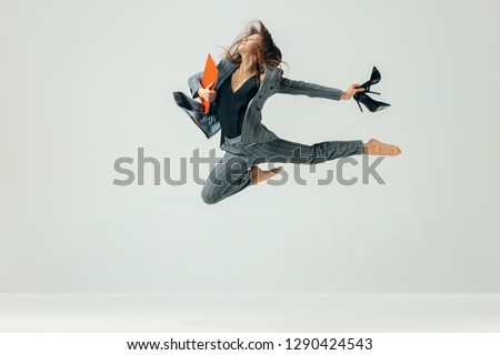 Happy business woman dancing and smiling in motion isolated over white studio background. Human emotions concept.  The businesswoman, office, success, elegance, grace, performer, flexible concepts #1290424543