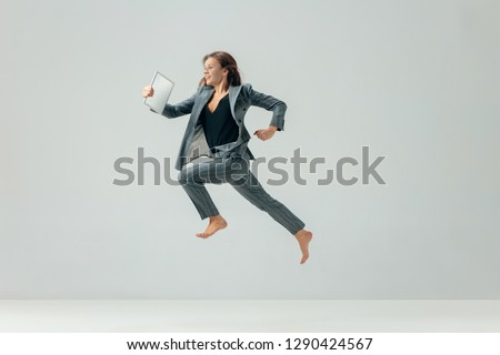 Happy business woman dancing and smiling in motion isolated over white studio background. Human emotions concept.  The businesswoman, office, success, elegance, grace, performer, flexible concepts #1290424567