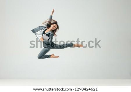 Happy business woman dancing and smiling in motion isolated over white studio background. Human emotions concept.  The businesswoman, office, success, elegance, grace, performer, flexible concepts #1290424621