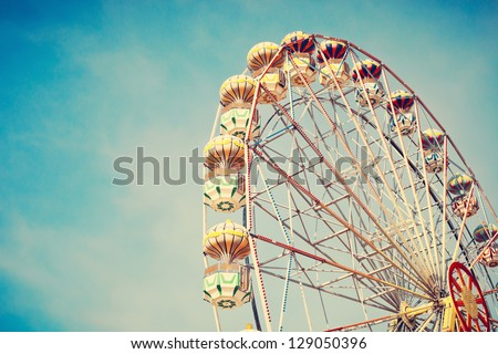 Ferris Wheel Over Blue Sky Royalty-Free Stock Photo #129050396