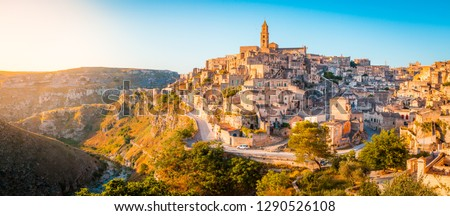 Panoramic view of the ancient town of Matera (Sassi di Matera) in beautiful golden morning light at sunrise, Basilicata, southern Italy #1290526108
