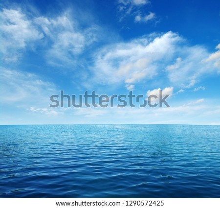 Blue sea water surface on sky #1290572425