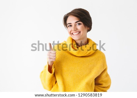Happy cheerful girl wearing hoodie standing isolated over white background, thumbs up #1290583819