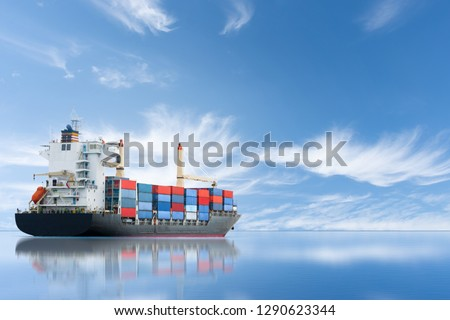 Cargo new ship carrying container and running for export  goods  from  cargo yard port to other ocean concept freight shipping ship on blue sky background. #1290623344