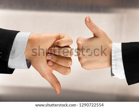 Human hands showing agree sign Versus disagree on background #1290722554