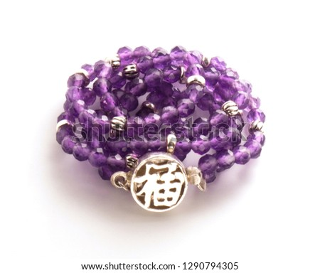 Purple necklace with a medallion on a white background #1290794305