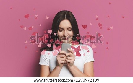 Valentine day concept, love mail - hearts flying out smartphone in womans hands #1290972109