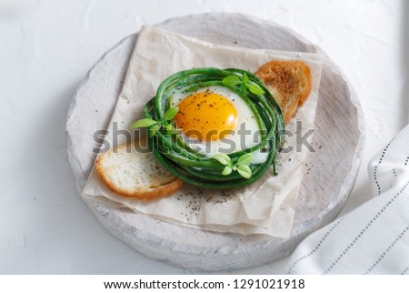 Green beans with sunny side fried egg on toast #1291021918