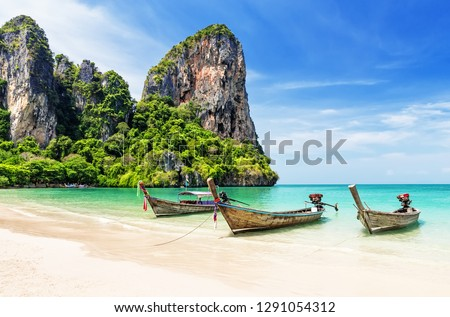 Thai traditional wooden longtail boat and beautiful sand Railay Beach in Krabi province. Ao Nang, Thailand. Royalty-Free Stock Photo #1291054312
