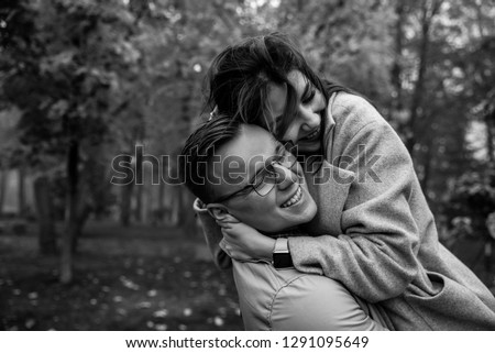 Couple in love. Black and white photo of a young happy couple, they hugging and laughing #1291095649