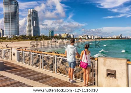 Miami beach tourists couple walking in South Beach, Miami, Florida. USA travel. #1291116010