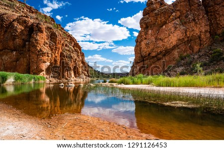Scenic panorama of Glen Helen gorge in West MacDonnell National Park in NT central outback Australia Royalty-Free Stock Photo #1291126453