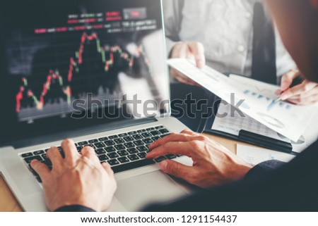 Business Team Investment Entrepreneur Trading discussing and analysis graph stock market trading,stock chart concept #1291154437