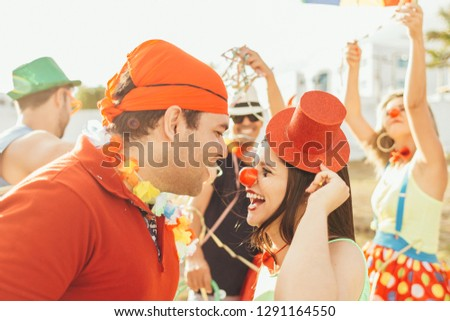 Brazilian Carnival. Couple in costume enjoying the carnival party in the city #1291164550